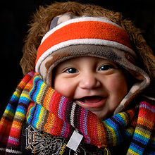 220px-Well-clothed_baby